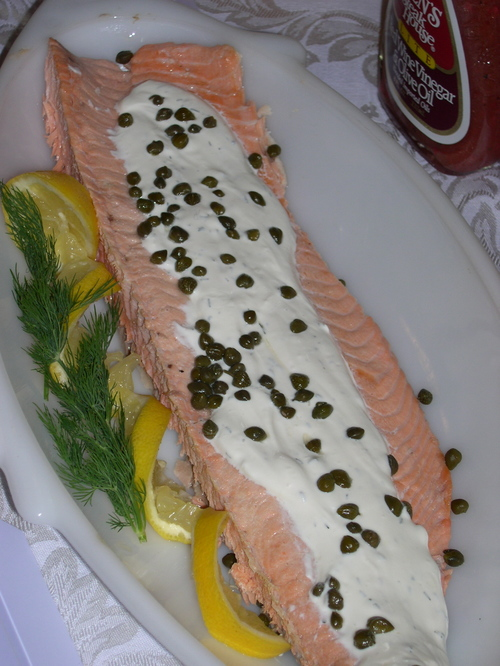 Poached salmon with dill sauce and capers